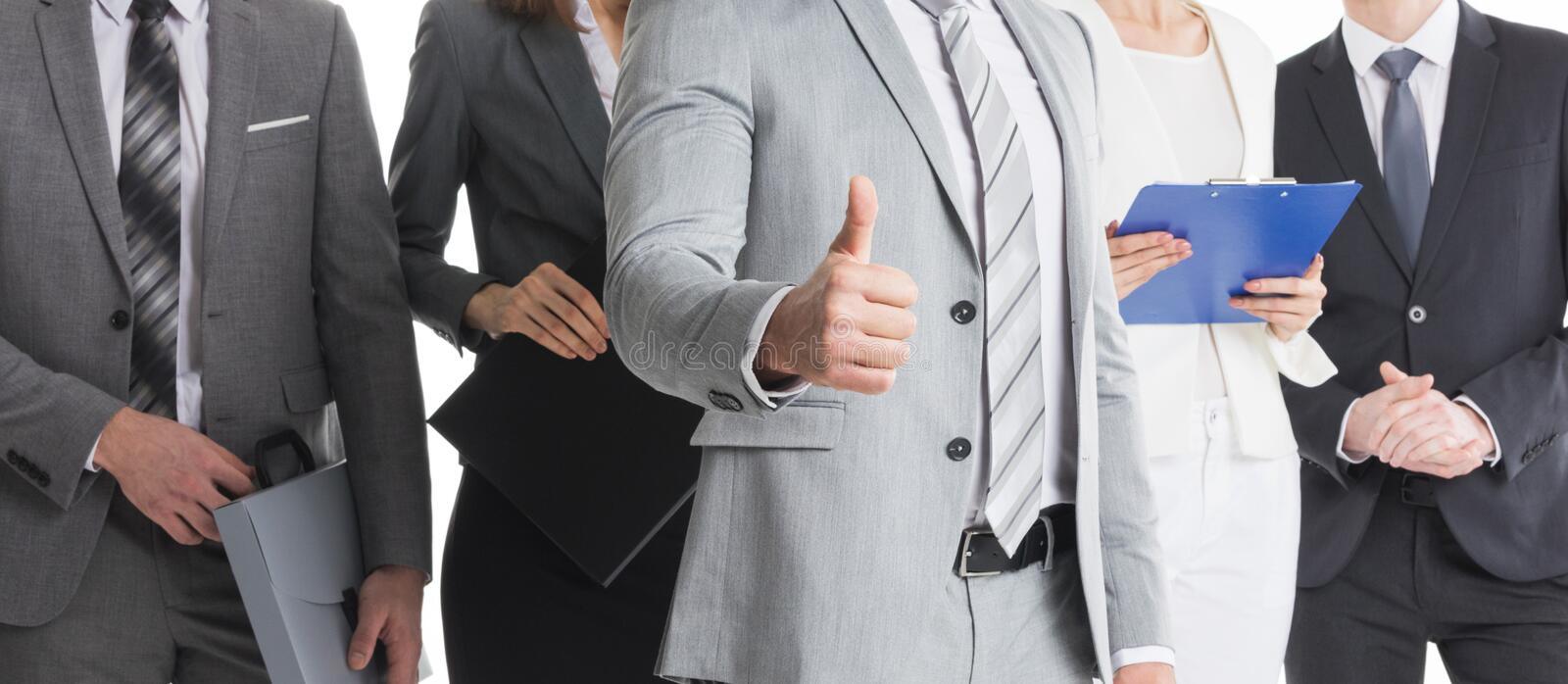 Business people show thumb up stock photography