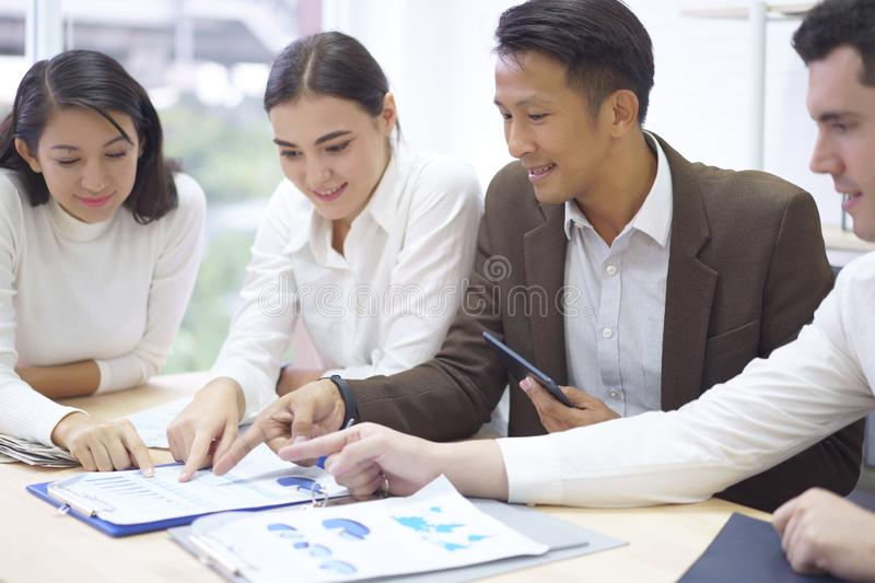 Business people groups planning work the charts and graphs, hands pointing at business document during discussion meeting at royalty free stock images