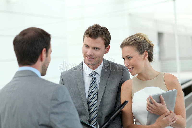 Business people in hallway discussing royalty free stock image
