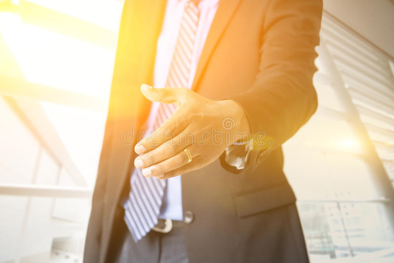 Business people hand offering handshake royalty free stock photography