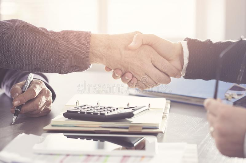 Business people hand shaking after a deal in office royalty free stock photos