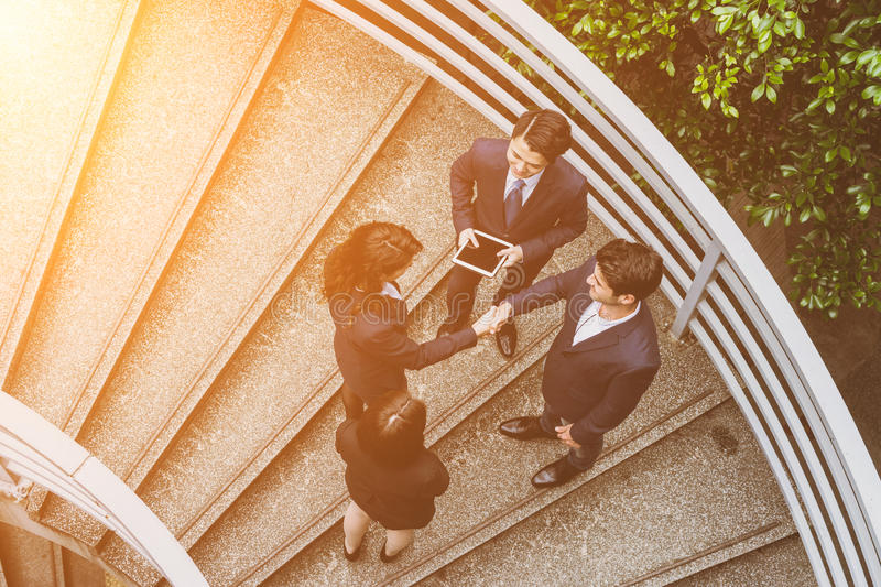Business people hand shaking. Top view of business people hand shaking to each other royalty free stock photo