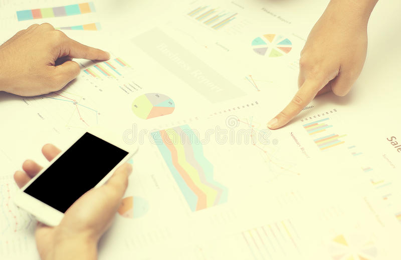 Business people hands analyst team work group during discussing financial review, business charts. Point finger at graph document stock photos