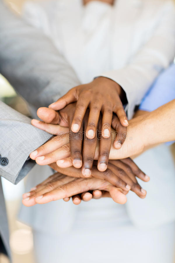 Business people hands together. Close up of business people hands together royalty free stock images