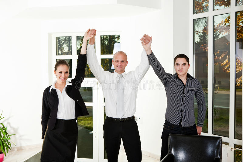 Business people. With hands up in office stock image