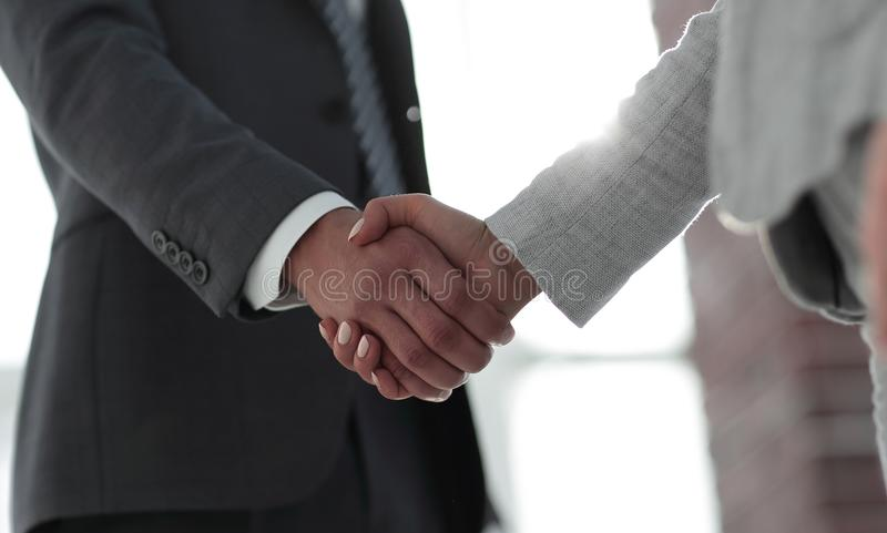 Business people shaking hands isolated on white background. Business people handshake in modern office. Greeting deal concept royalty free stock photo