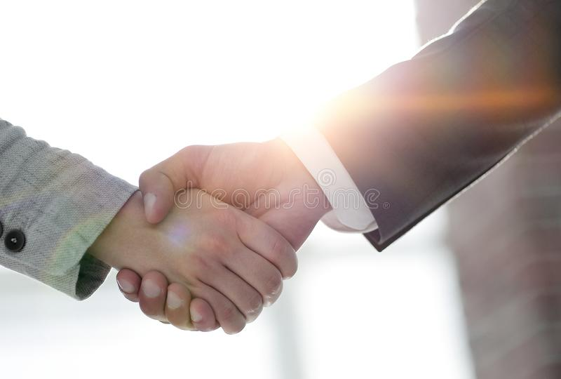Business people shaking hands isolated on white background. Business people handshake in modern office. Greeting deal concept royalty free stock photography