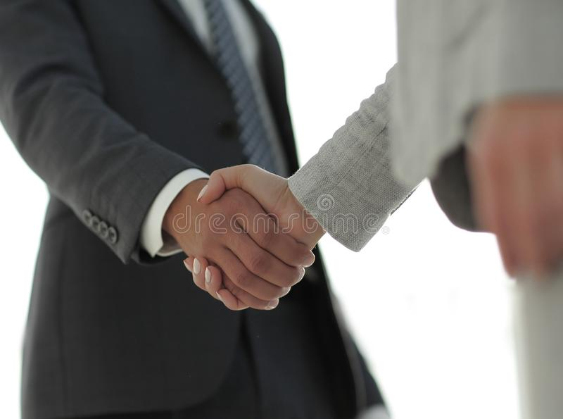 Business people shaking hands isolated on white background. Business people handshake in modern office. Greeting deal concept stock images