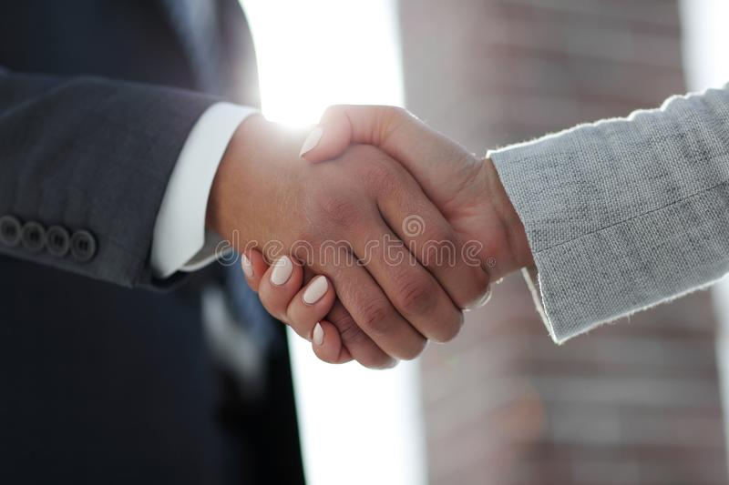 Business people shaking hands isolated on white background. Business people handshake in modern office. Greeting deal concept stock photos
