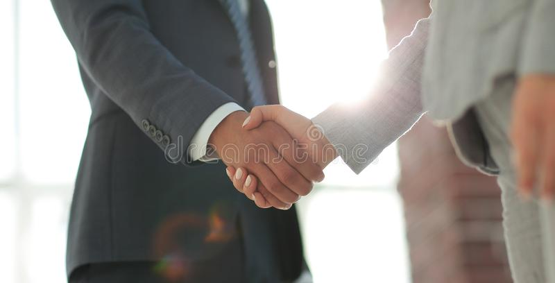 Business people shaking hands on white background. Business people handshake in modern office. Greeting deal concept stock photo