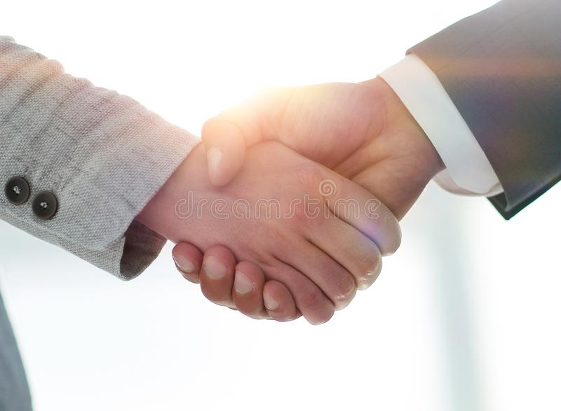 Business people shaking hands on white background. Business people handshake in modern office. Greeting deal concept royalty free stock image
