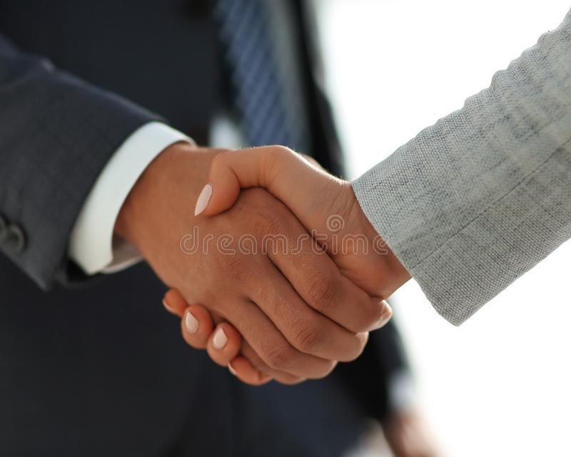 Business people shaking hands on white background. Business people handshake in modern office. Greeting deal concept royalty free stock photo