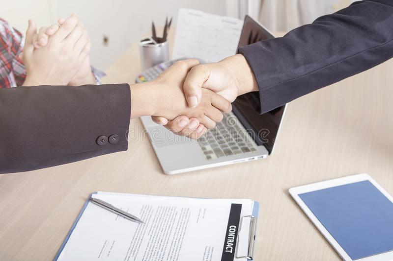 Business people handshaking after finished deal together. Success business and financial concept. stock image
