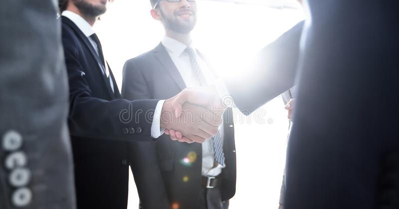 Business people handshaking after good deal. Successful business people handshaking after good deal stock photography