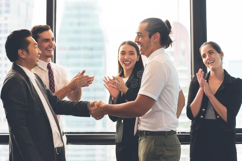 Business People Handshaking after greeting deal. With men and women clapping hands background royalty free stock photo