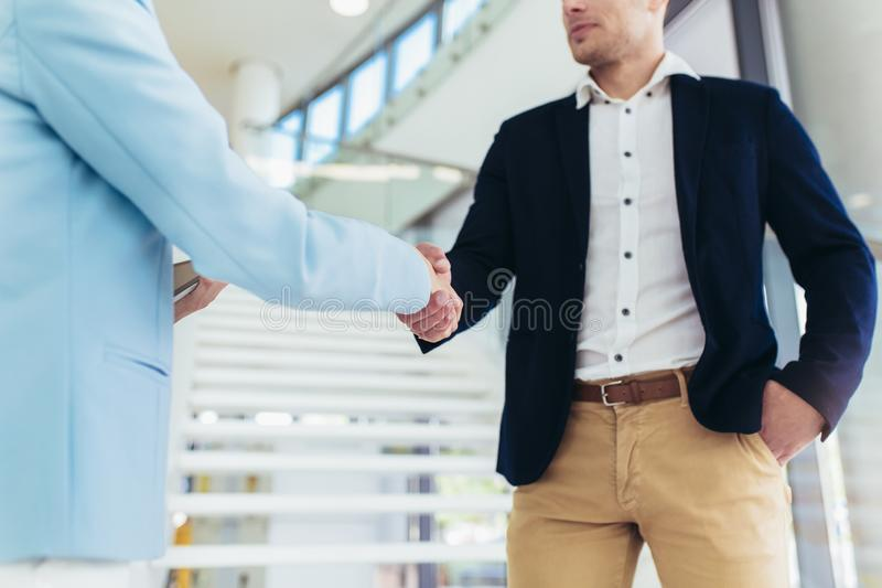 Business people handshaking in office stock image