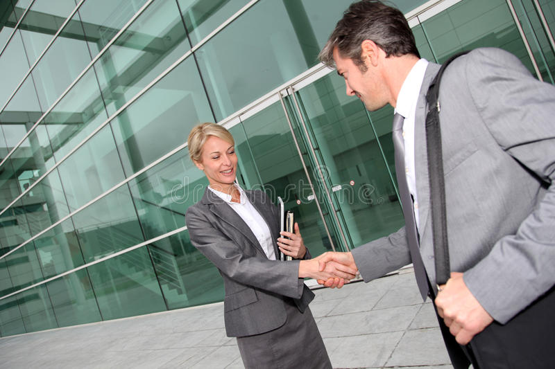 Business people handshaking. Business people shaking hands after meeting royalty free stock image