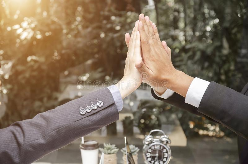 Business people happy showing team work and giving five after signing agreement or contract with foreign partners in office royalty free stock photo