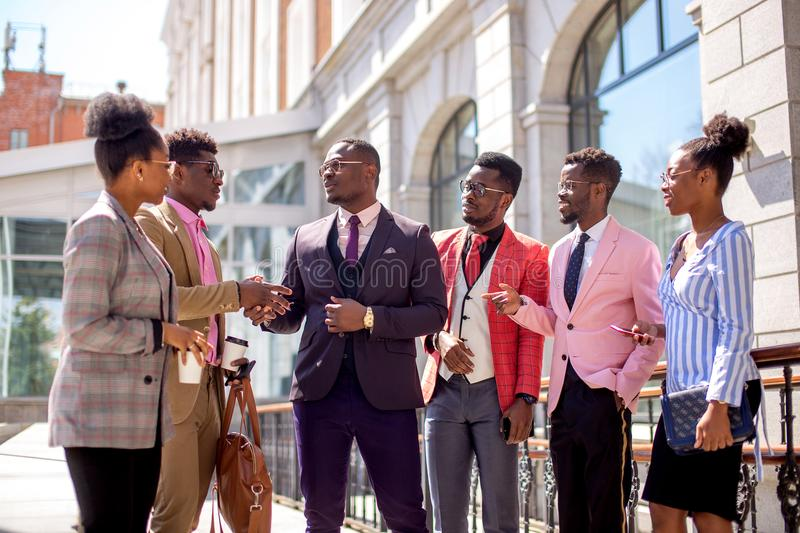 Business people have concluded a contract with each other. Mutual agreement.employees are acquainting with new colleague royalty free stock image