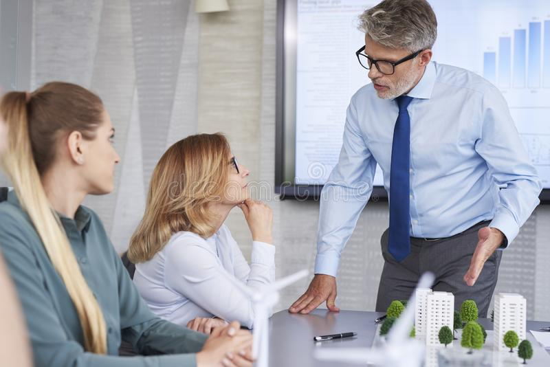 Business people having arguments with boss royalty free stock photography