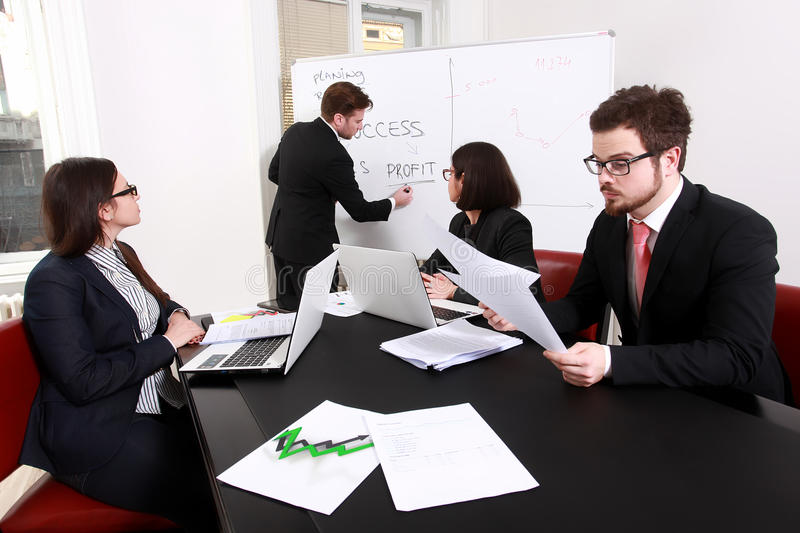 Business people having board meeting stock photography