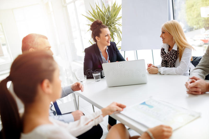Business people having a board meeting stock photography