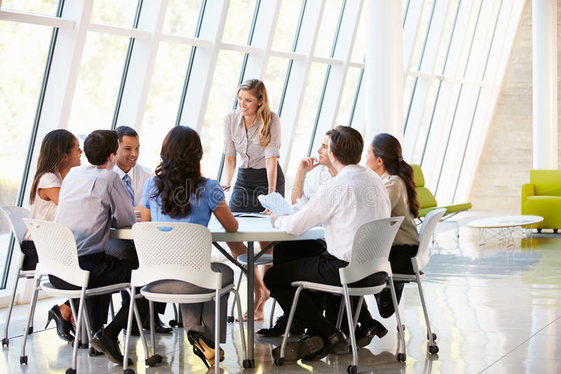 Business People Having Board Meeting In Modern Office stock photography