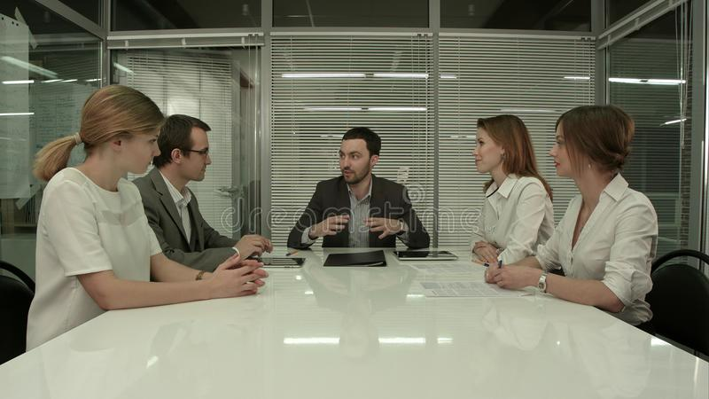 Business People Having Board Meeting In Modern Office stock images