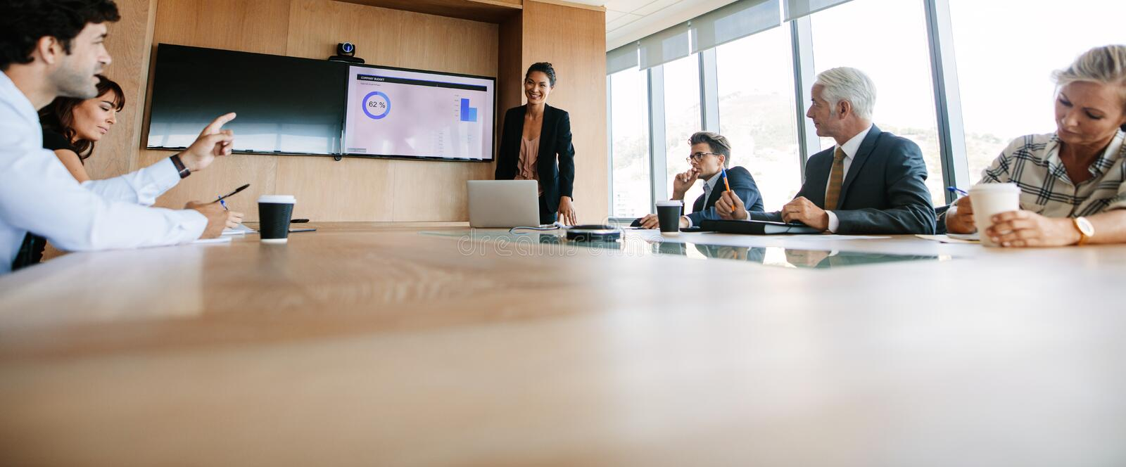 Business people having board meeting in modern office royalty free stock photos