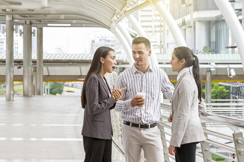 Business people having casual meeting. Business people having casual meeting during a coffee break stock photo