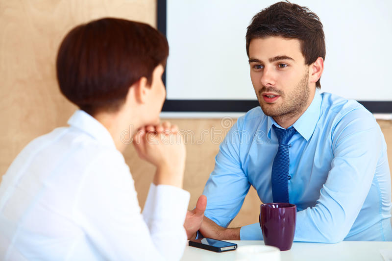 Business People having conversation with colleague during break.  royalty free stock images