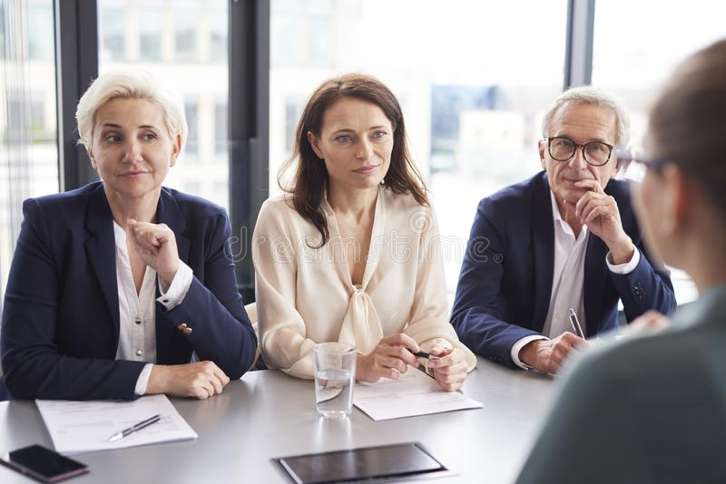 Business people having a conversation at conference table stock photos