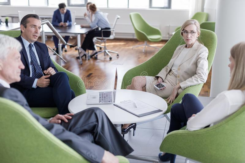 Business people having discussion stock photos