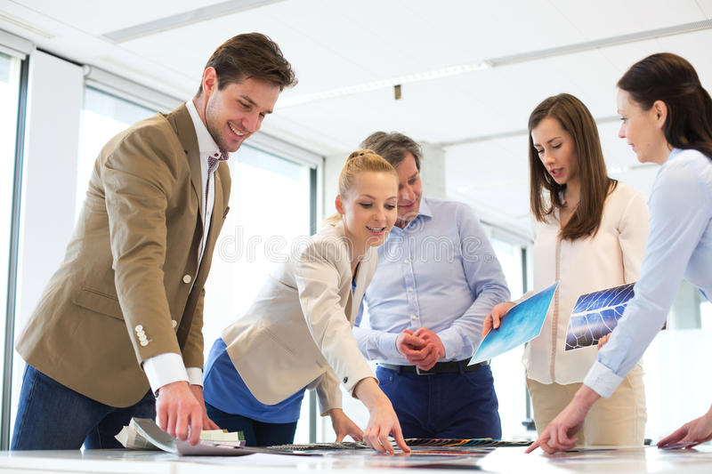 Business people having discussion at table in new office stock photo