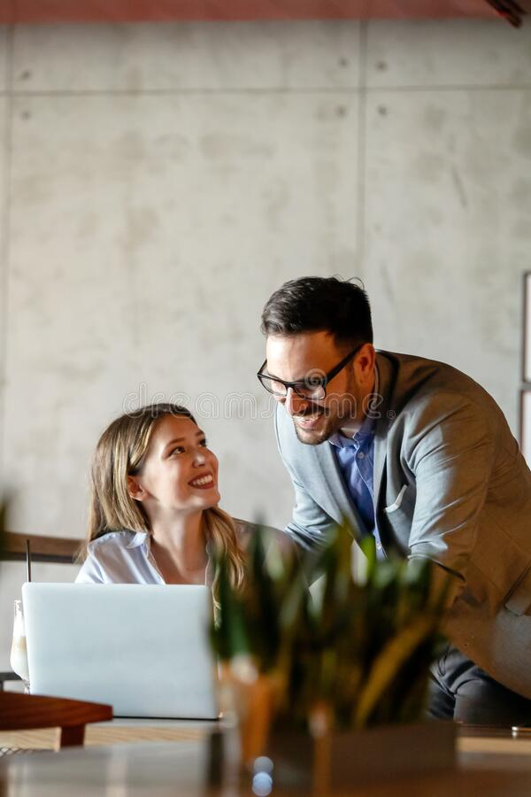 Business people having fun and chatting at workplace office stock photos