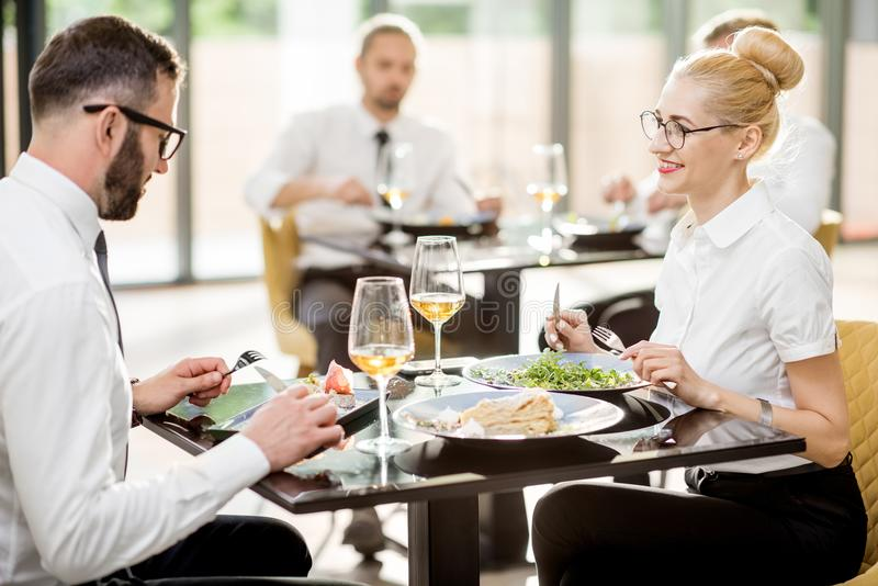 Business people during a lunch at the restaurant royalty free stock photo
