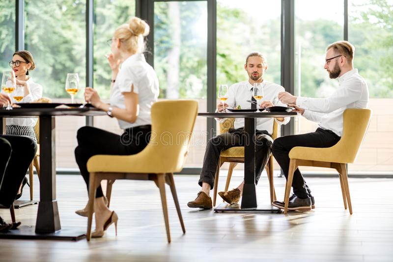 Business people during a lunch at the restaurant royalty free stock images