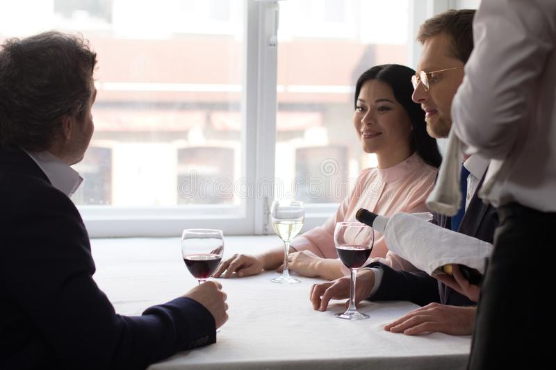 Business people having lunch at luxury restaurant stock photography