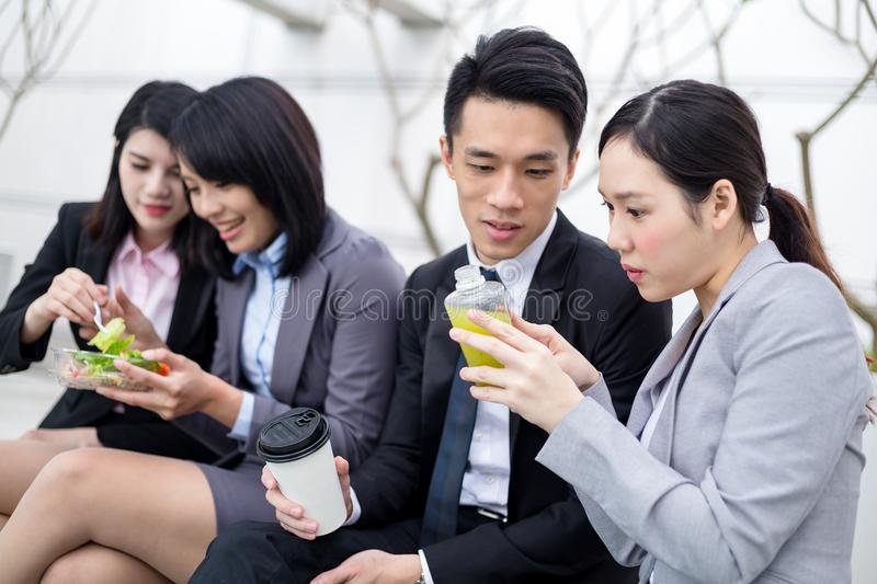 Business people having lunch at outdoor stock image