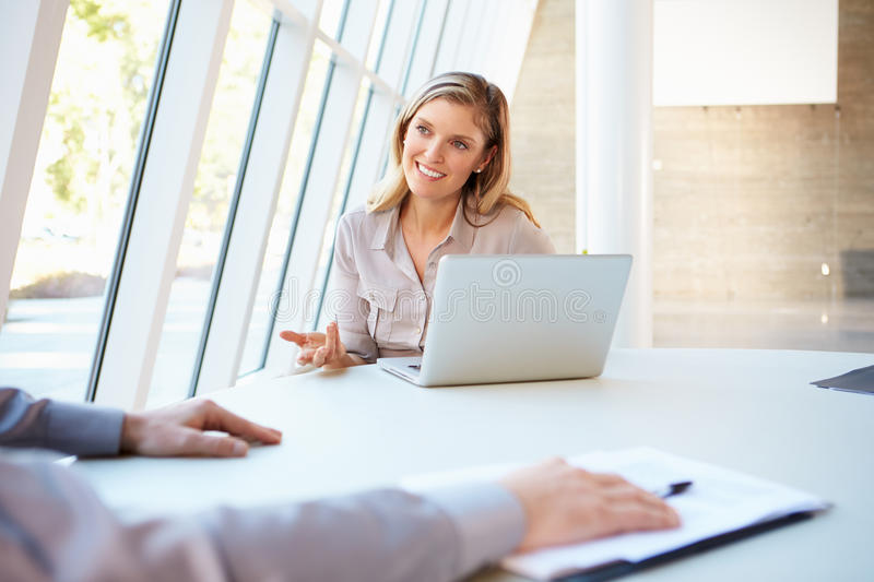 Business people Having Meeting Around Table In Modern Office stock images