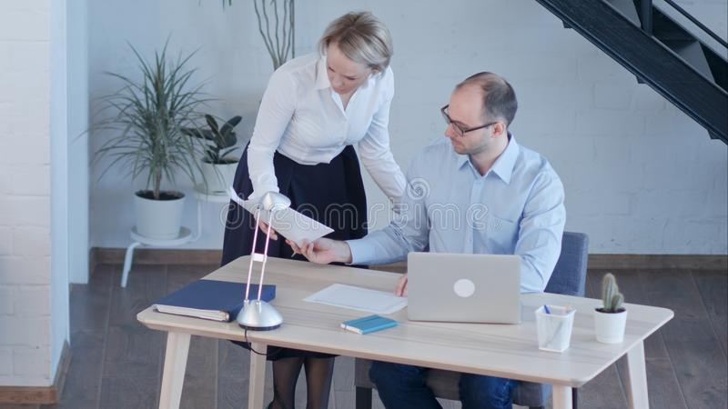 Business people having meeting around table in modern office royalty free stock photography