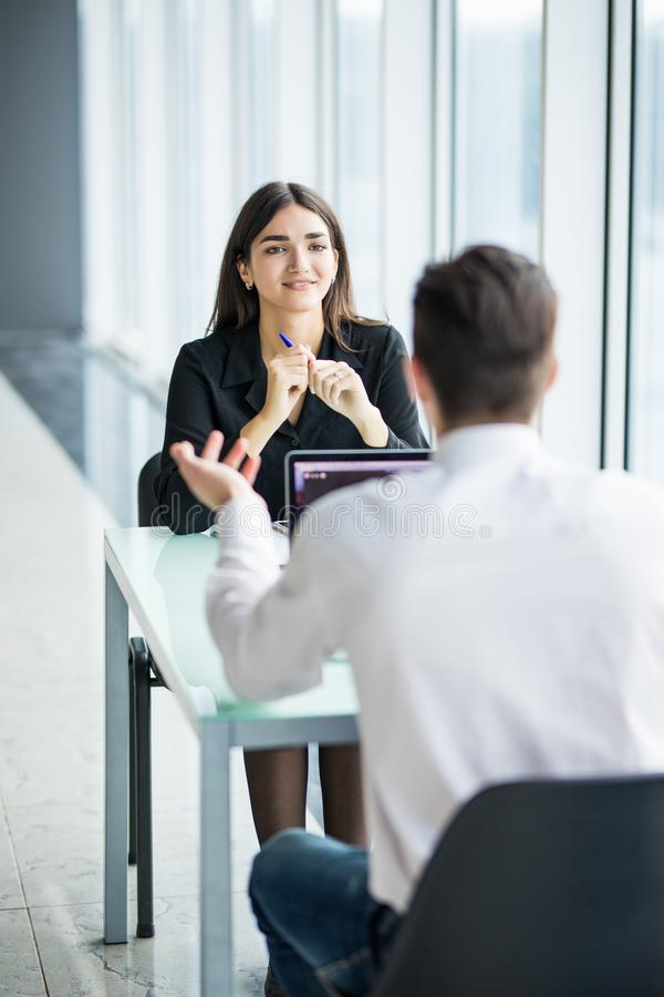 Business people man and woman Having Meeting at Table In Modern Office against panoramic windows. Focus on woman. stock image