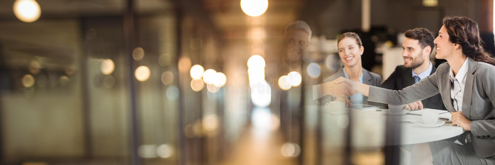 Business people having a meeting with blurry lights transition effect royalty free stock image