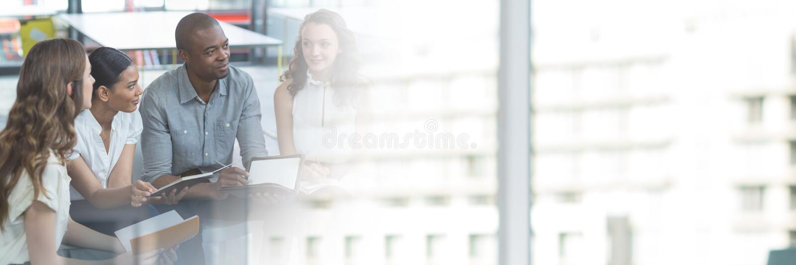 Business people having a meeting with building transition effect royalty free stock image