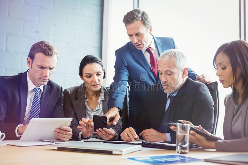 Business people having meeting in conference room royalty free stock images