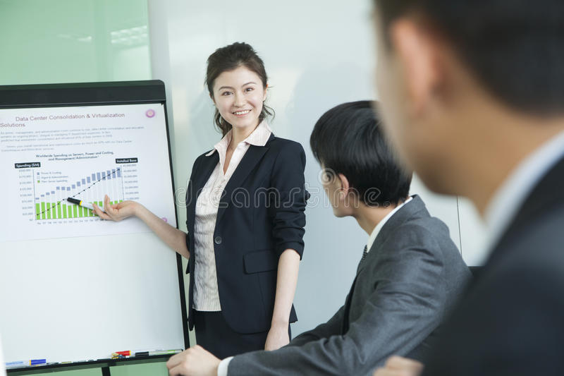 Business people having meeting, doing a presentation royalty free stock image