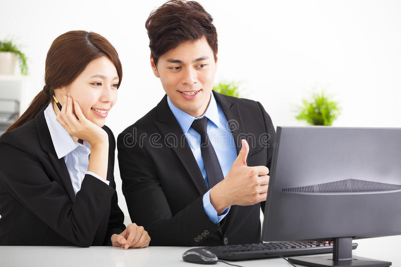 Business people Having Meeting and looking the compute stock photography