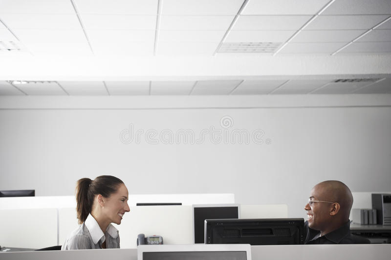 Business People Having Meeting In Office Cubicle royalty free stock photo