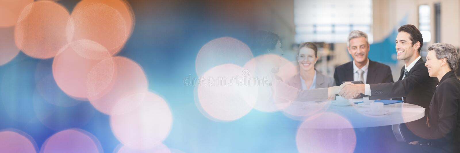 Business people having a meeting with sparkling lights bokeh transition effect stock image