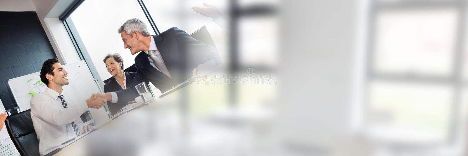Business people having a meeting with windows transition effect stock images